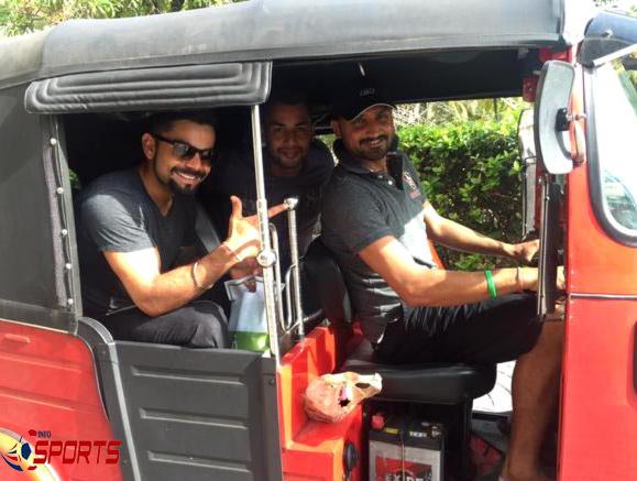 Harbhajan Singh, Virat Kohli and Stuart Binny enjoy a ride in the 'tuk-tuk'.