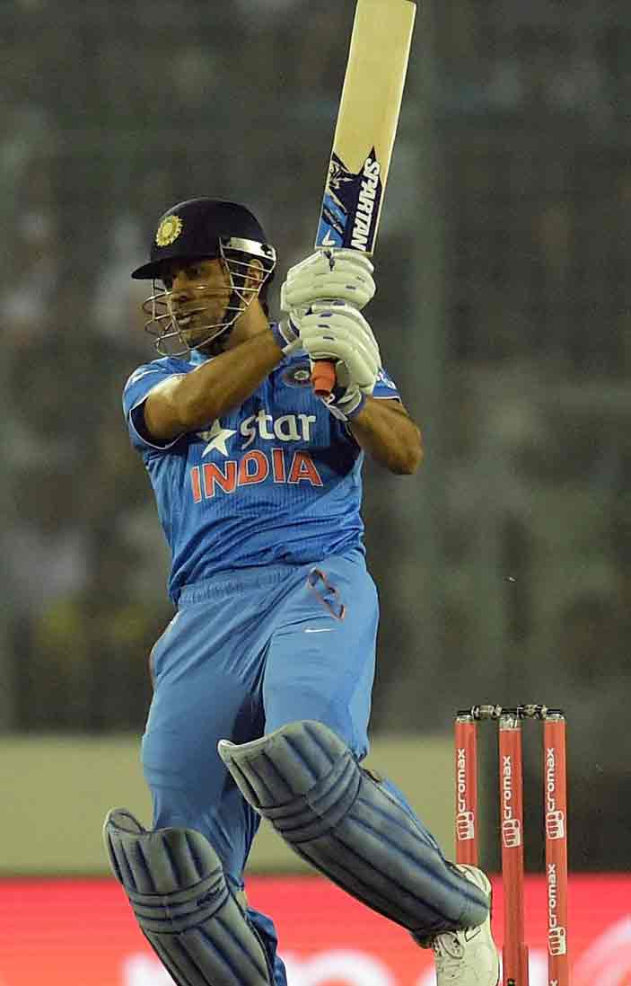 Indian cricket captain Mahendra Singh Dhoni plays a shot