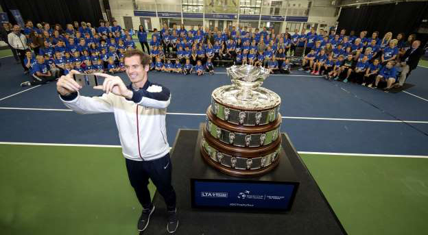 andy-murray-takes-a-selfie-with-school-children-while-attending-the-davis-cup-trophy