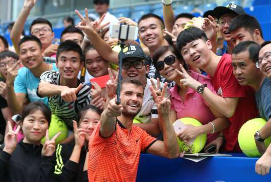 grigor-dimitrov-of-bulgaria-takes-a-selfie-with-fans