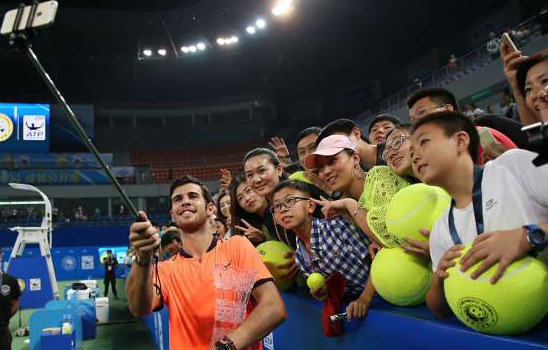 karen-khachanov-of-russia-takes-selfie-with-fans