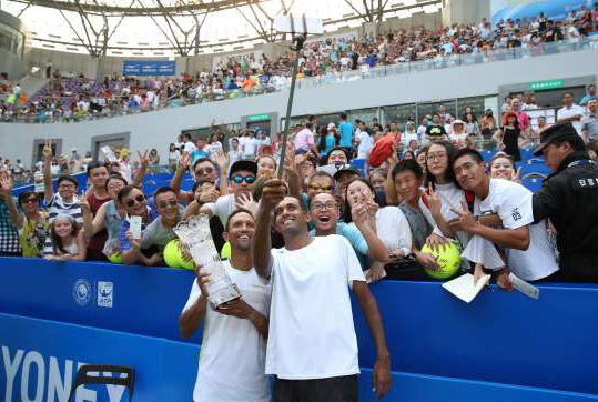 raven-klaasen-of-south-africa-left-and-rajeev-ram-of-the-united-states-take-selfie-with-fans