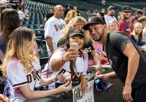 silvino-bracho-of-the-diamondbacks-poses-for-a-selfie-with-a-fan