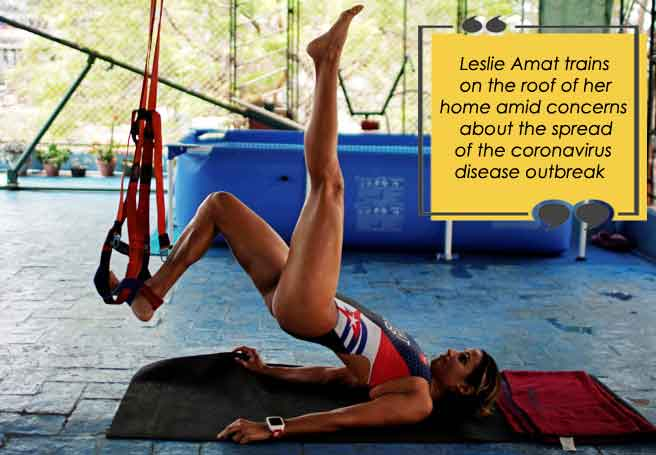Cuban triathlete Leslie Amat trains on the roof of her home
