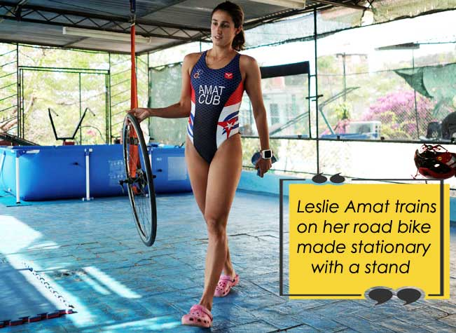 Leslie Amat trains on her road bike made stationary with a stand